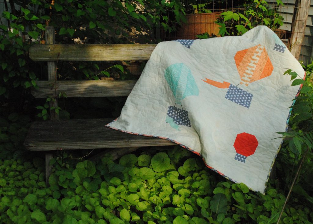 Hot air balloon quilt on bench