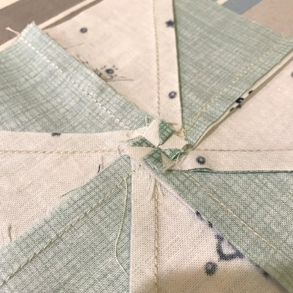 How to press a pinwheel block flat. How to reduce bulk in pinwheel seams.